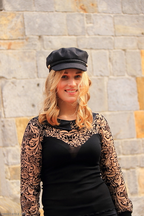 Beautiful blond dutch girl wearing black lace dress in the street. Streetstyle fashion.