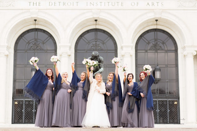 bridesmaids at detroit institute of arts cheering