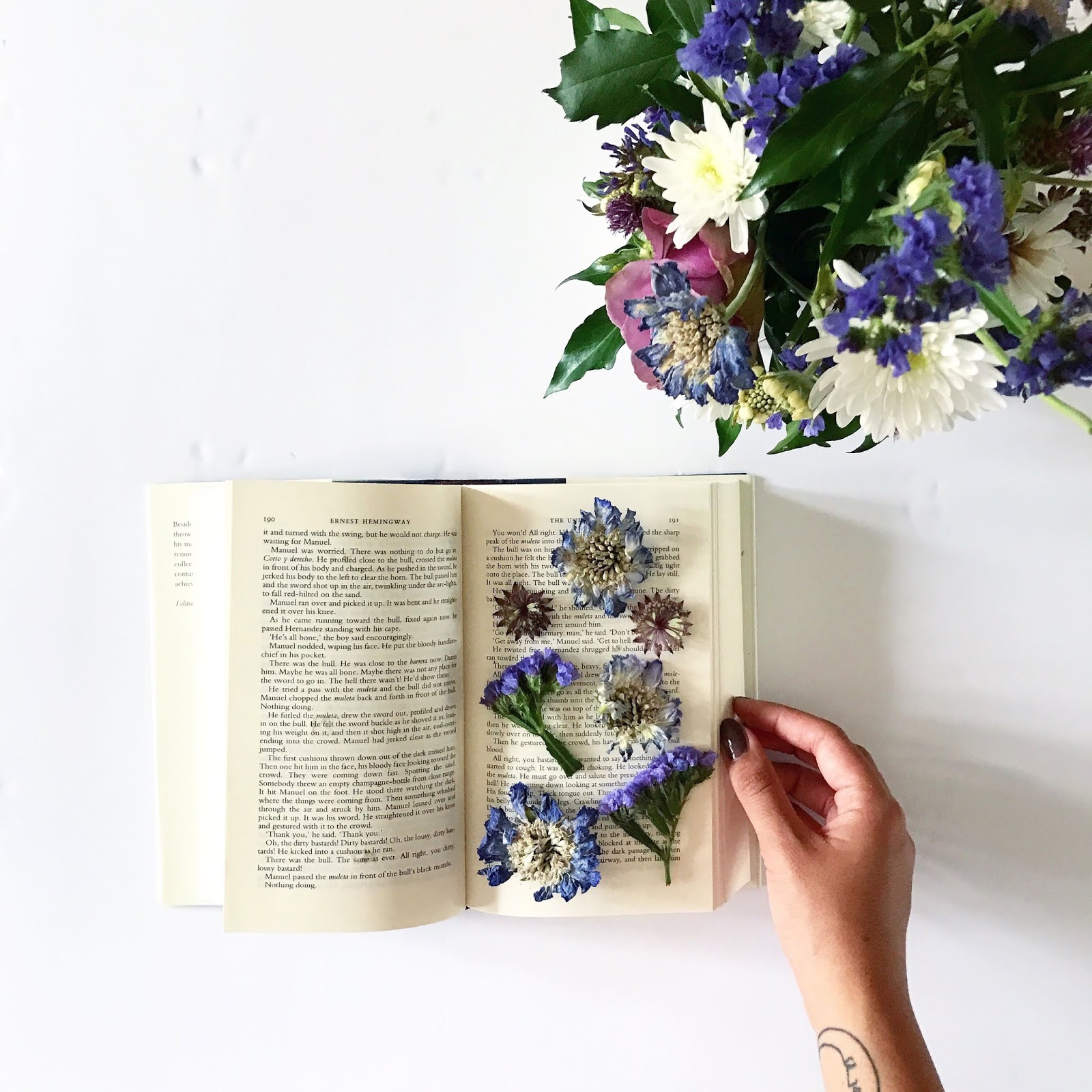 book with pressed flowers on pages