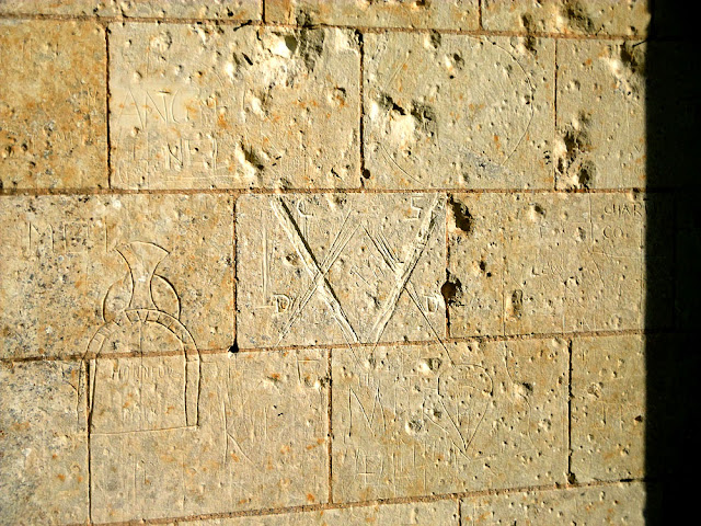 Graffiti inside the ruined church of Les Roches Tranchelion, Indre et Loire, France. Photo by Loire Valley Time Travel.
