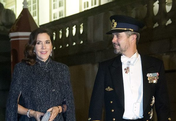 Crown Princess Mary wore Julie Fagerholt Heartmade Benina cape and Lasse Spangenberg gown, J Furmini clutch. Crown Prince Frederik