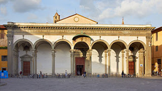 The loggia facade of the Basilica della Santissima  Annunziata in Florence, where Carucci was buried