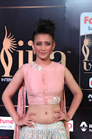 Akshara Haasan in Peachy Crop Top Choli Skirt at IIFA Utsavam Awards 23.JPG