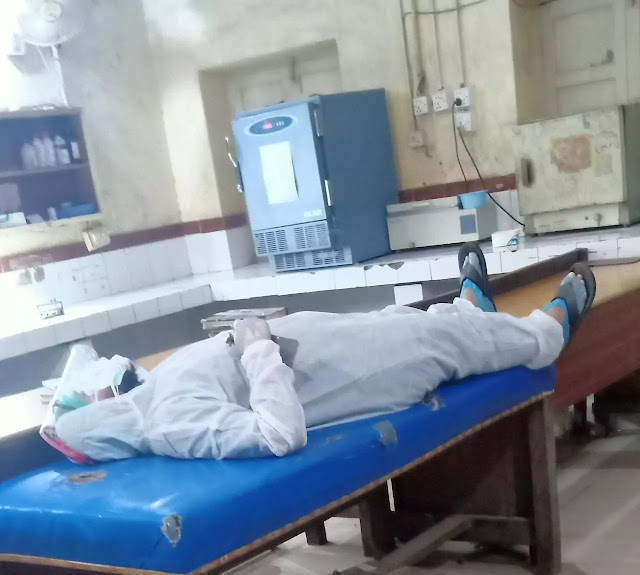 Dr suffering from coronavirus taking sampling testing in Civil hospital Mirpurkhas