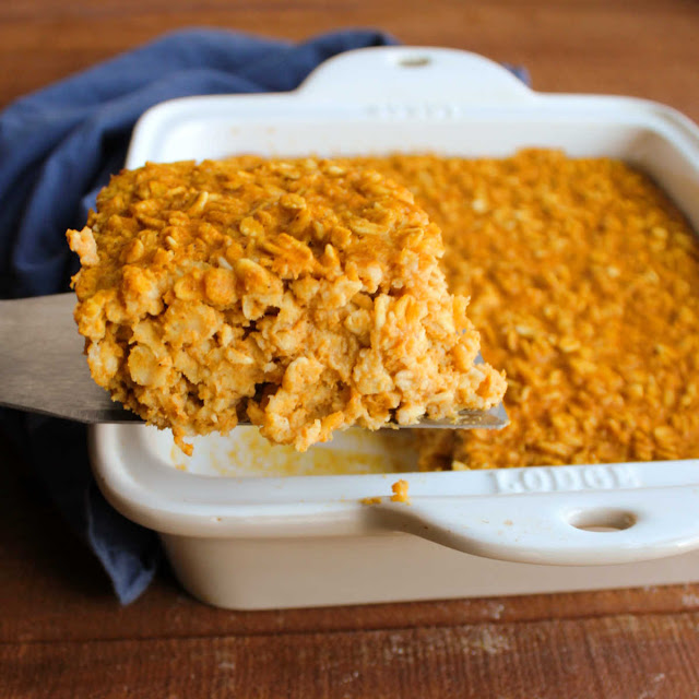 spatula lifting piece of pumpkin pie baked oatmeal out of baking dish