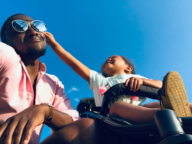 Black father with child in stroller (Canva-photo) Celebrate Juneteenth