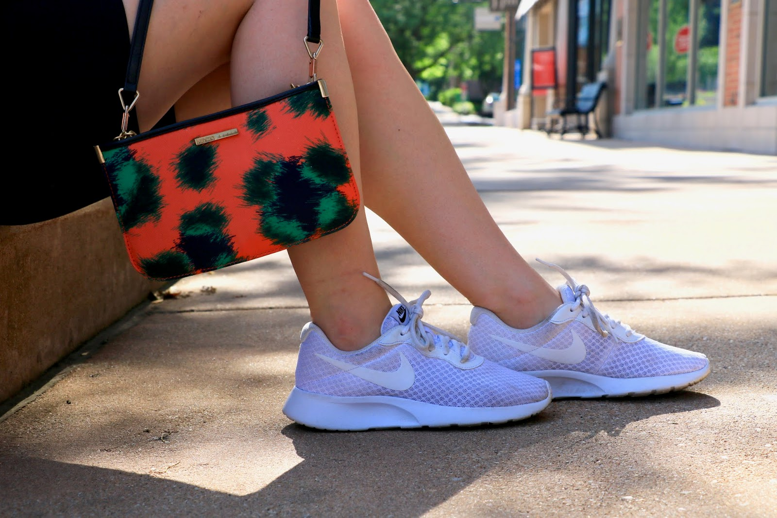 Nyc fashion blogger Kathleen Harper carrying a printed Kenzo purse and wearing white Nike sneakers.