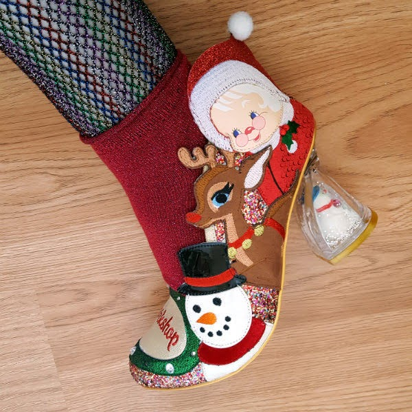 festive christmas shoe with snowman snowglobe heel