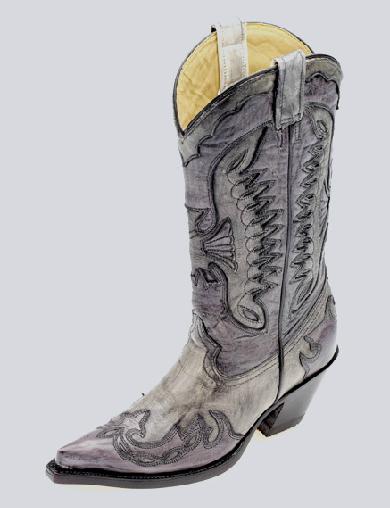 El diseño del tubo es algo elaborado con tonos purpuras muy bonitos y la  punta u horma muy clasica western. cabe decir que los tacones que maneja  siempre o ... e36af028d34