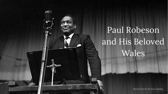 'Paul Robeson and His Beloved Wales' next to a photo of Paul Robeson onstage at the National Eisteddfod in 1958