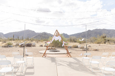 ceremony arch and white tank mountains backdrop