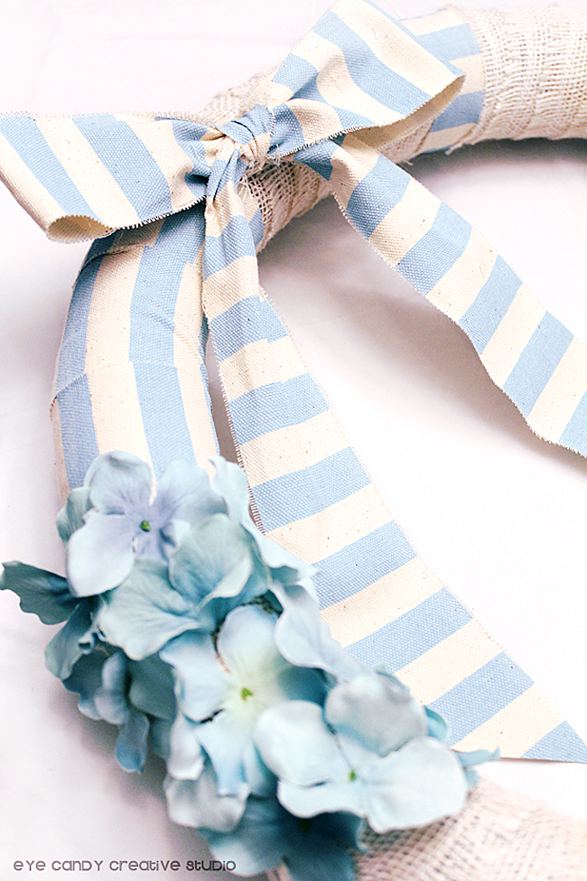 light blue stripe ribbon, flowers on wreath, how to make a spring wreath