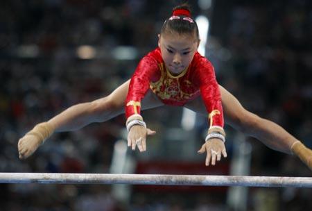 gymnastics training  cast handstand on uneven bars