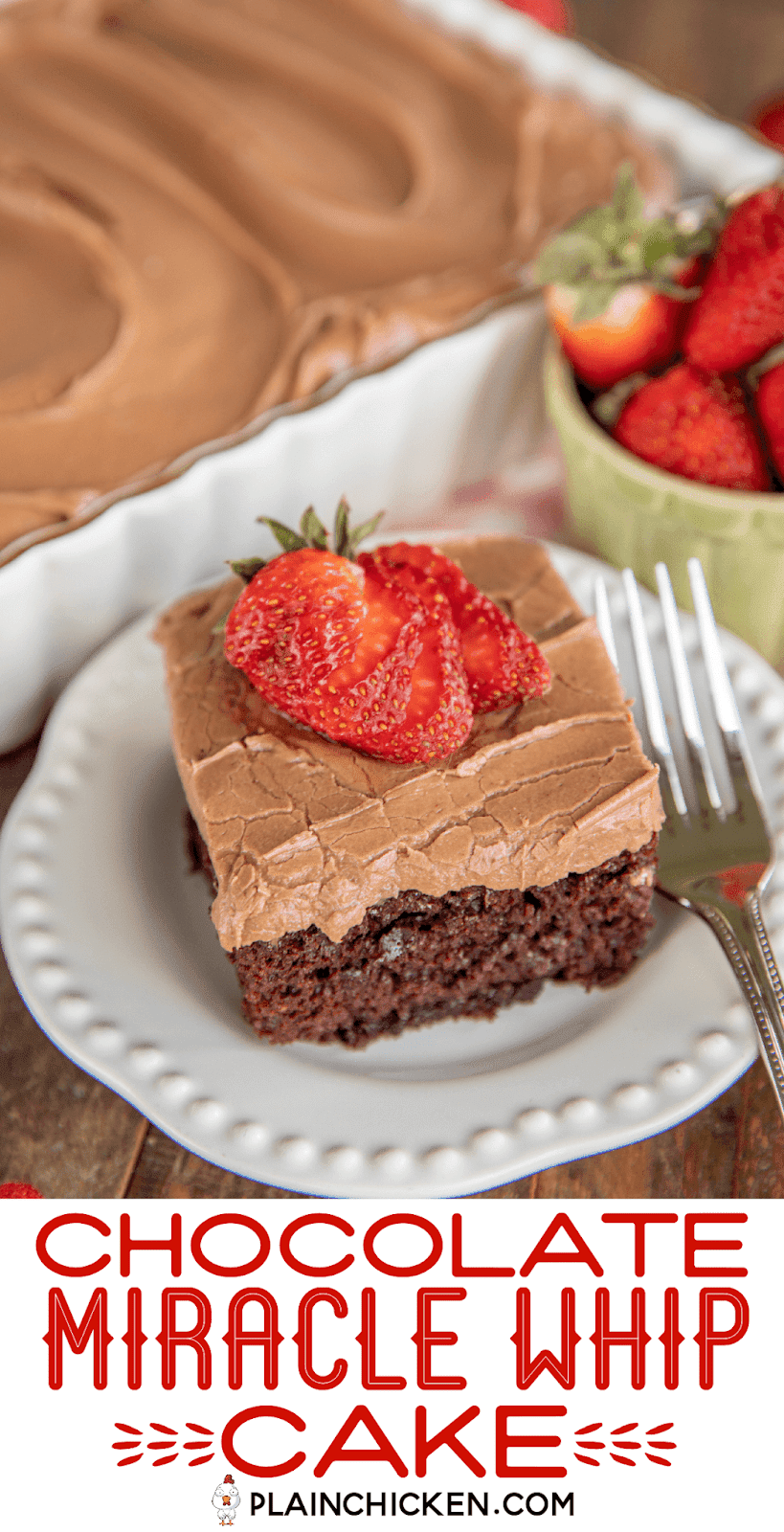slice of chocolate cake on a plate topped with strawberries