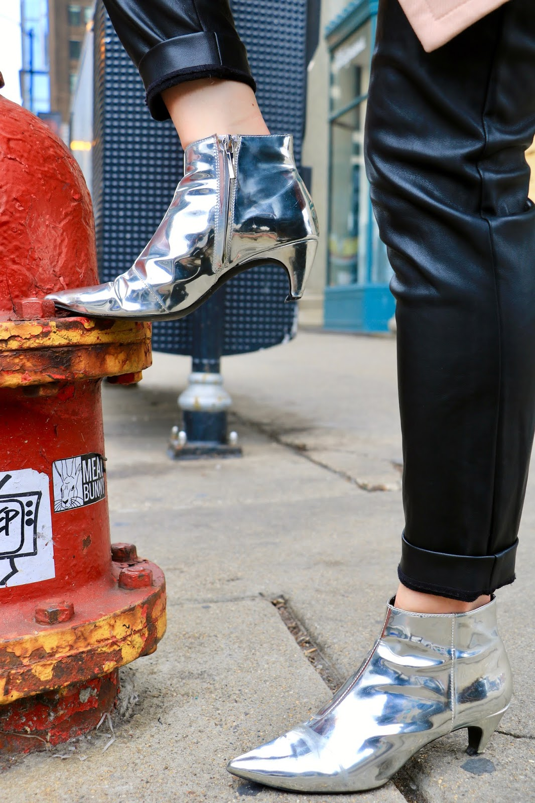 Chicago fashion blogger Kathleen Harper wearing metallic silver boots from Zara.