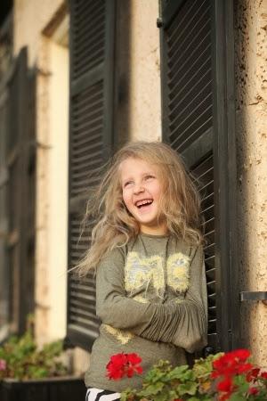 NAMC Montessori motivation in the environment laughing girl