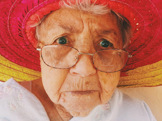 Woman with red and yellow hat wearing glasses