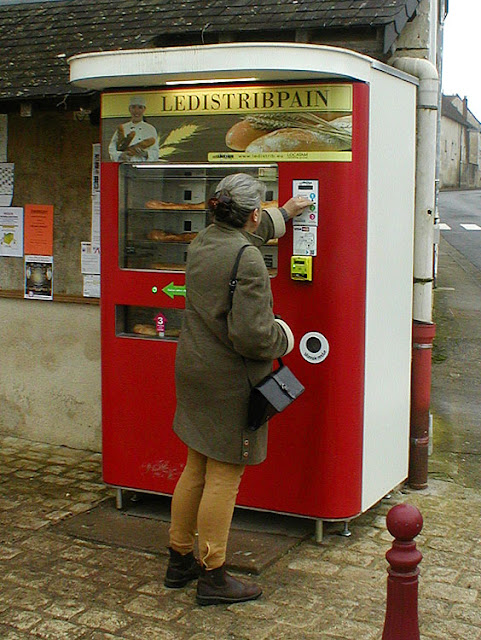 Buying a baguette from a vending machine, Indre et Loire, France. Photo by Loire Valley Time Travel.