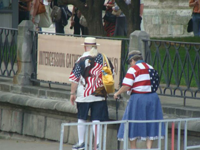 How to spot the American tourists. An older couple wearing Americana shirts. The Smell of Freedom and other stories about 'merica. marchmatron.com