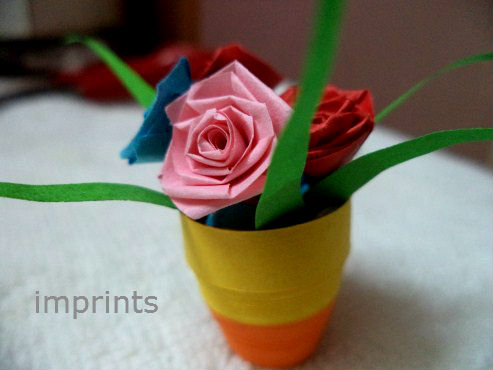 http://www.imprintshandmade.com/2013/07/how-to-make-paper-quill-flower-pot.html