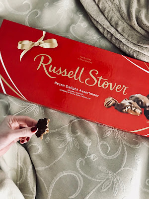 Photo of large box of chocolates in bed