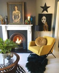 Ochre velvet chair in black and white room