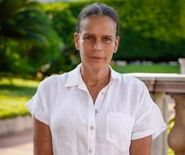 Princess Stephanie wore white linen shirt and Tory Burch high-waisted wide leg trousers