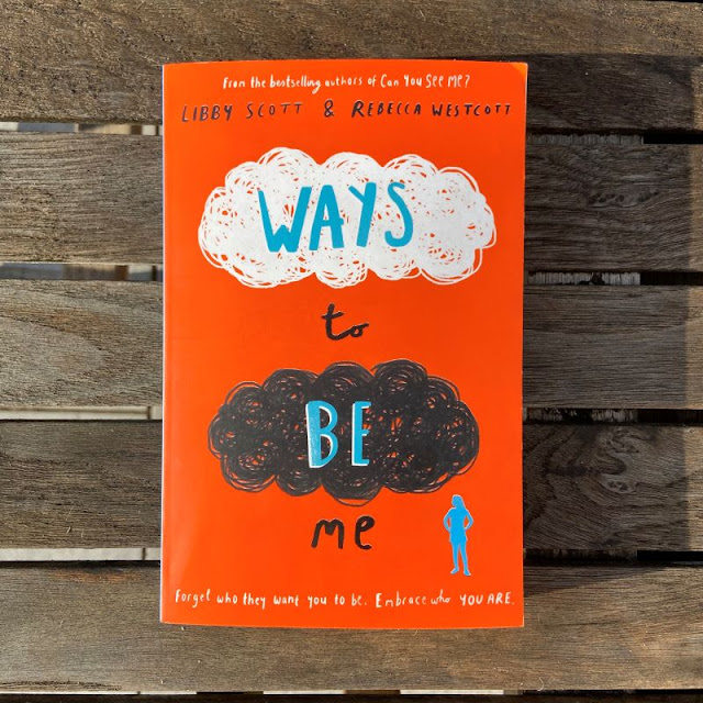 Orange book cover with title Ways to be me and authors names, and white and black cloud scribbles