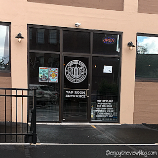 """glass door that says """"Wooden Cask Brewery Tap Room Entrance"""""""
