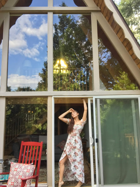 An epic reflection in the A-frame windows of Toad Haven Cottage