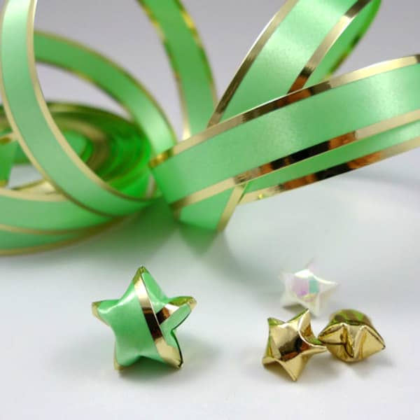 green, gold, and white folded lucky stars with curled ribbon