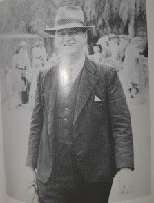 Bob Wake in hat and suit, jovial