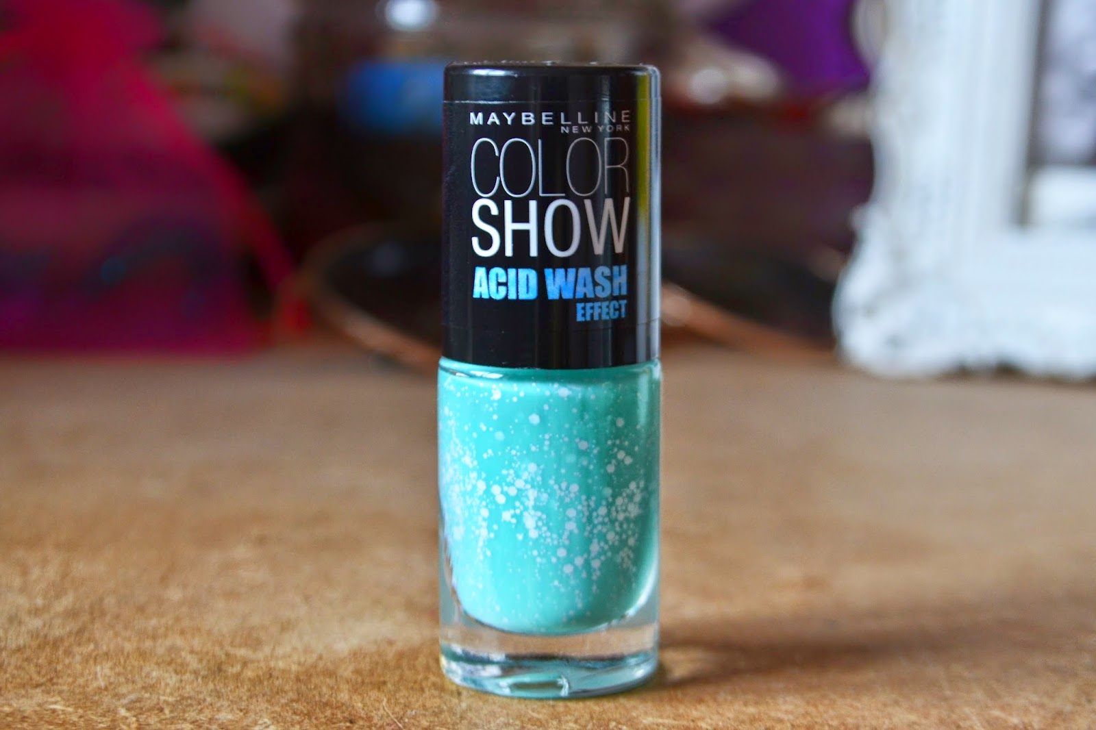 A BOTTLE OF TURQUOISE ACID WASH NAIL VARNISH