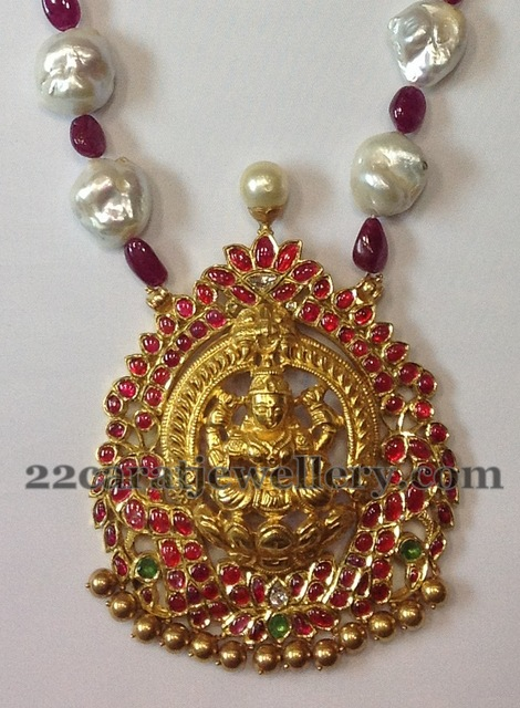 Heavy Lakshmi Devi Rubies Locket Jewellery Designs