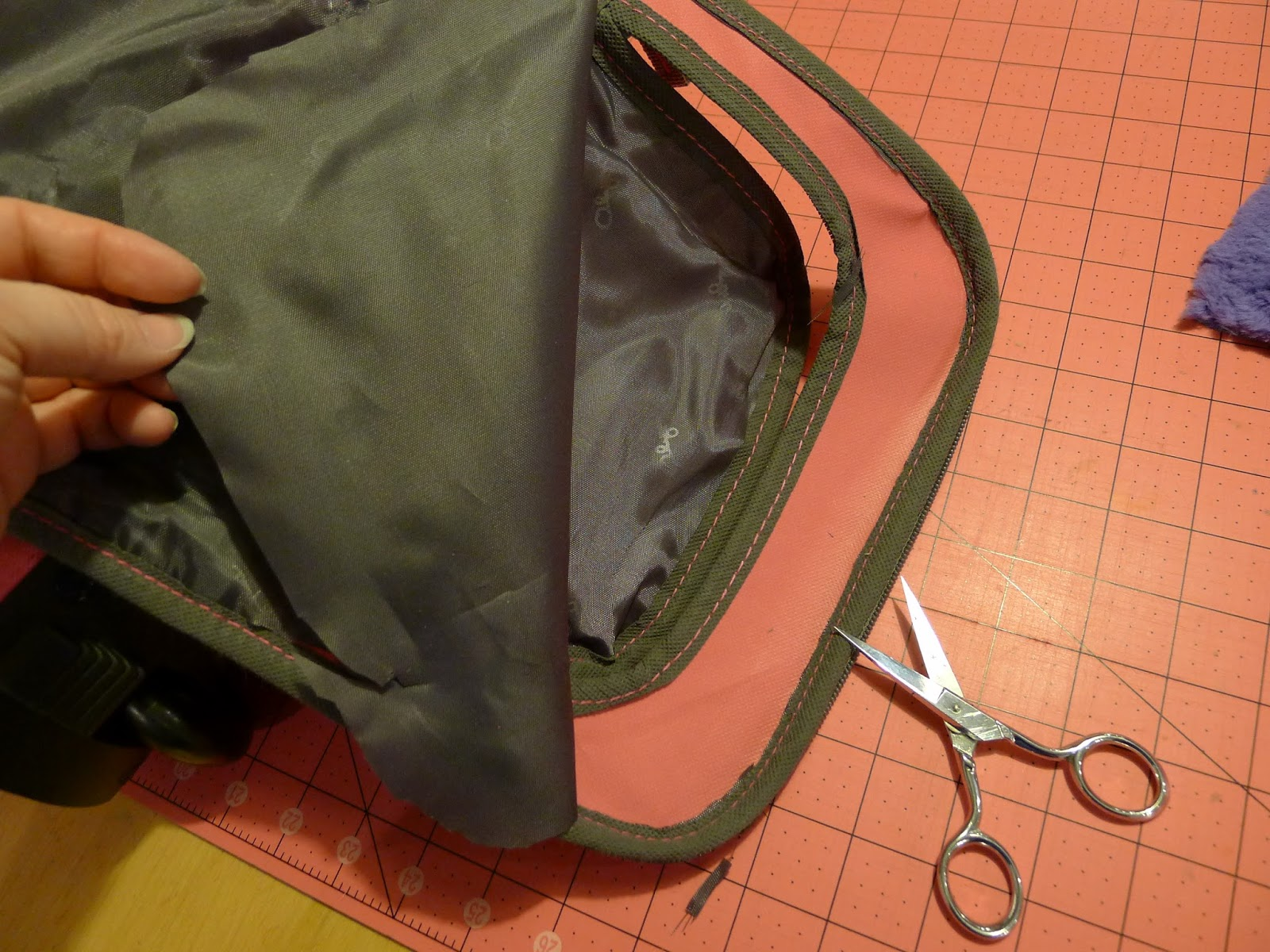 6712ef6b8df5 Use some scratch paper to make a pattern for the size and shape of the  opening flap of the pocket. (If you're using the same suitcase, you can use  my ...