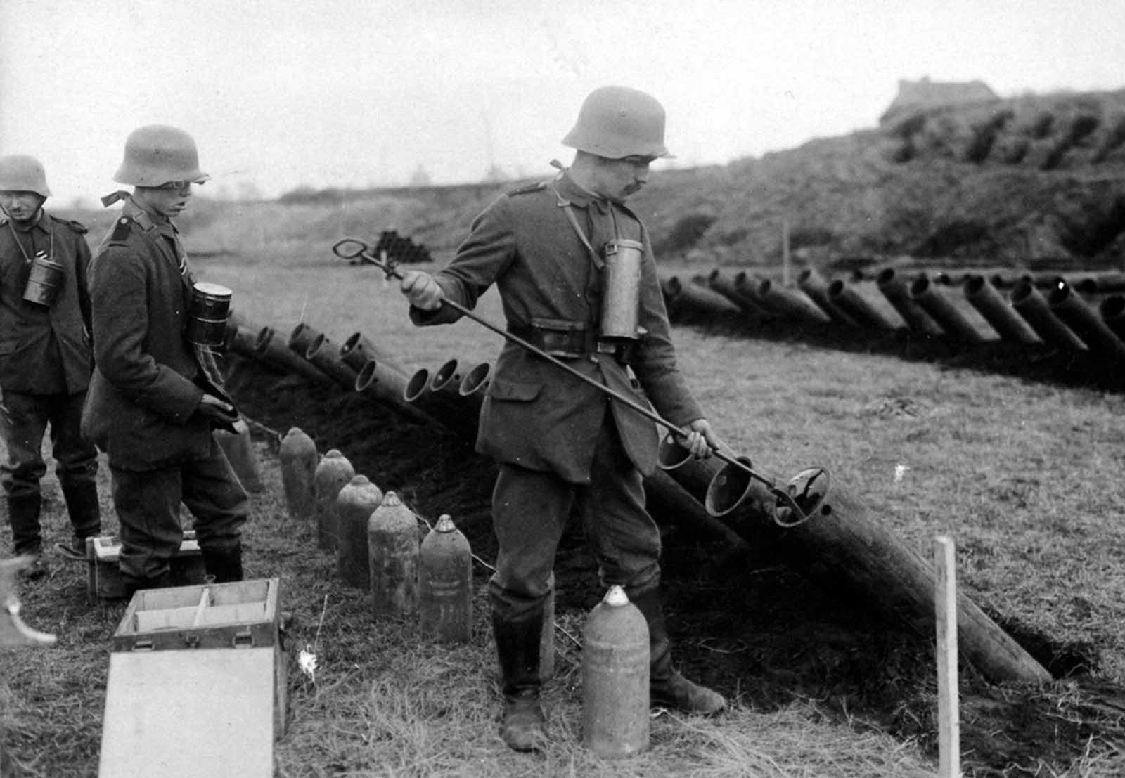German troops load gas projectors. Attempting to exploit a loophole in international laws against the uses of gas in warfare, some German officials noted that only gas projectiles appeared to be specifically banned, and that no prohibition could be found against simply releasing deadly chemical weapons and allowing th wind to carry it to the enemy.