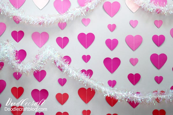 Dangling heart wall back ground is the perfect addition to any Valentine's day decor.