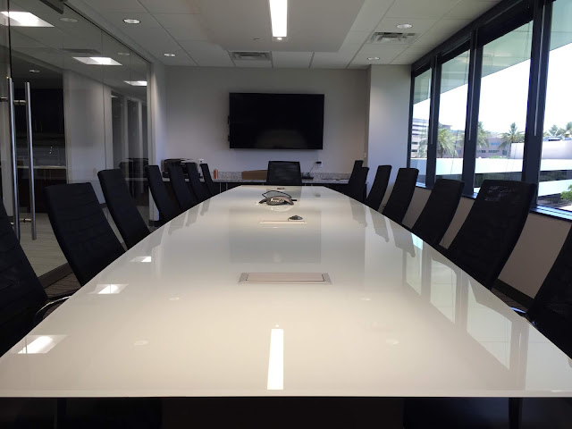 A prolonged glass conference table