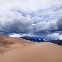 kate hart on top of a dune at Great Sand Dunes, Colorado
