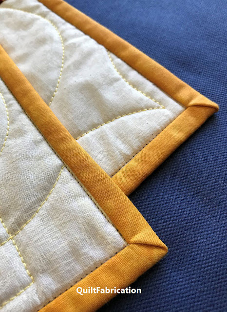 flat beautiful quilt corners using the reduce bulky corners tutorial from QuiltFabrication