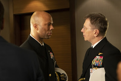 Common and Gary Oldman stare each other down in military uniforms in the 2018 film Hunter Killer