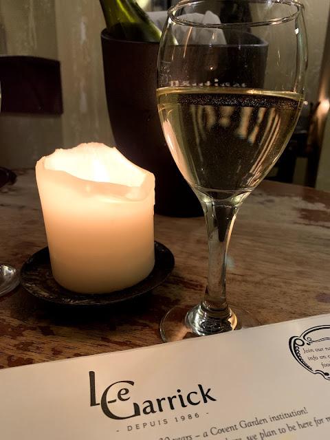 wine, candle and Le Garrick menu header