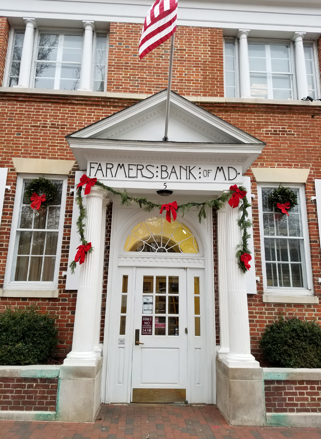 brick home decorated for Christmas