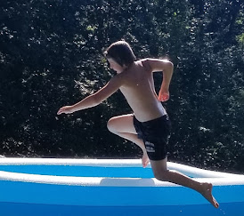 Grandson leaping into cool, cool water.
