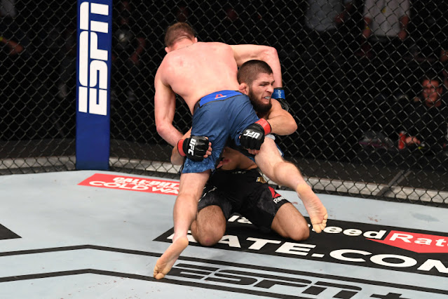 UFC 254 - Khabib Nurmagomedov lifts Justin Gaethje