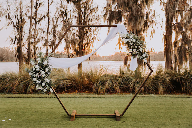 ceremony hexagon arch with flowers