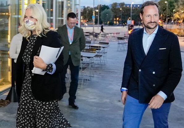 Crown Princess Mette-Marit wore a birds-flying print midi dress by Pia Tjelta. Crown Prince Haakon accompanied Crown Princess Mette-Marit
