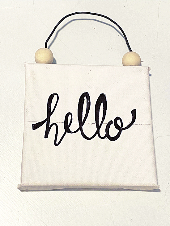 hello sign with a line drawn across the canvas