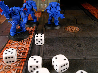 A unit of Intercessor Space Marines take aim.