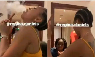 Regina Daniels comes under fire as she caught smoking in the presence of 2Face's daughter